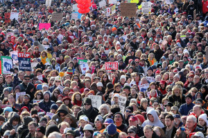 MADISON, WI - MARCH 12:  Thousands of demonstrators protest outside the Wisconsin State Capitol March 12, 2011 in Madison, Wisconsin. Organizers were expecting 200 thousand participants to attend the rally to voice their opposition to Governor Scott Walker public sector union reforms.  (Photo by Scott Olson/Getty Images)