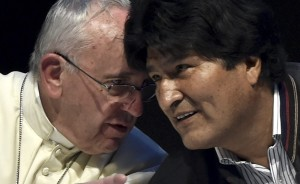 Pope Francis (L) speaks with Bolivian President Evo Morales during the Second World Meeting of the Popular Movements at the Expo Feria Exhibition Centre, in Santa Cruz, Bolivia, on July 9, 2015. Pope Francis, a champion of the poor and social justice, on Thursday called on a million faithful to reject today's consumer society, at an open-air mass in Bolivia, South America's poorest nation.    AFP PHOTO / CRIS BOURONCLE        (Photo credit should read CRIS BOURONCLE/AFP/Getty Images)
